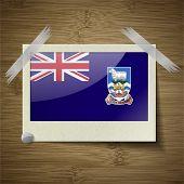 foto of falklands  - Flags of Falkland Islands at frame on wooden texture - JPG