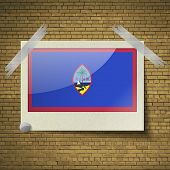 pic of guam  - Flags of Guam at frame on a brick background - JPG