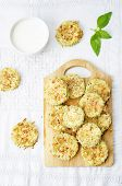 picture of crisps  - baked parmesan zucchini crisps on a white background - JPG
