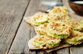 picture of crisps  - baked parmesan zucchini crisps on a dark wood background - JPG