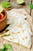 stock photo of cilantro  - Cilantro pesto quesadilla on dark wooden background - JPG