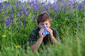 pic of excrement  - A teen boy with allergies in flowering herbs  - JPG