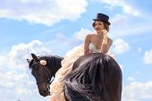 stock photo of horse girl  - Beautiful girl in vintage dress and her horse - JPG