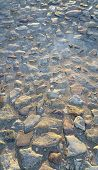 stock photo of paving  - Texture of road surface paved with rough stones - JPG