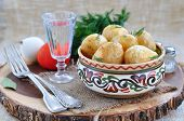 picture of baked potato  - baked potatoes in olive oil with fennel or dill - JPG