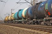 picture of train track  - Cargo train delivering oil traveling along the track