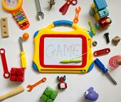 stock photo of kiddie  - kids fun background with toys and a magnetic Board for recording - JPG