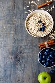 stock photo of cereal bowl  - Healthy Breakfast. Bowls with cereals and fresh berries on wooden table - health and diet concept. Top view. ** Note: Visible grain at 100%, best at smaller sizes - JPG