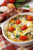 foto of baby goat  - Closeup of pan with fresh made frittata with baby kale sundried tomatoes and goat cheese - JPG