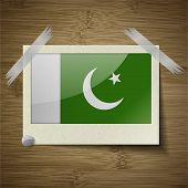 image of pakistani flag  - Flags of Pakistan at frame on wooden texture - JPG