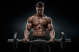 stock photo of bicep  - Closeup portrait of a muscular man workout with barbell at gym - JPG