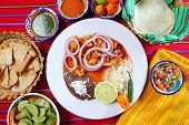 stock photo of poblano  - fajitas mexican food with rice frijoles and chili sauces - JPG