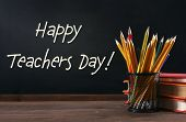 Teachers day concept. Text on chalkboard poster