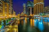 Chicago River skyline with urban skyscrapers at night, IL, USA poster