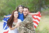 US army soldier with family and USA flag in park poster