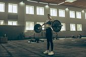 Fit Young Woman Lifting Barbells Working Out At A Gym. Sport, Fitness, Weightlifting, Bodybuilding,  poster
