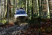 Rallying, Competition And Four Wheel Drive Concept. Sport Utility Vehicle Or Suv Overcomes Obstacles poster