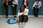 Teens bullying their classmate indoors poster