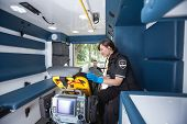picture of triage  - EMT worker listening to heart rate of patient - JPG