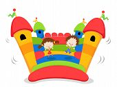 stock photo of bounce house  - Group Of Kids Jumping On A Bouncy Castle - JPG
