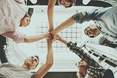 Students Standing In Circle And Holding Hands. Teamwork. Funny Students Years. Group Of Young Happy  poster
