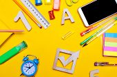 School Elections Concept. Election Check Box And School Accessories On A Desk On A Yellow Background poster