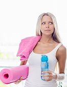 Young Blonde Woman Going Fitness Sport With Towel, Bottle Of Water And Yoga Mat poster