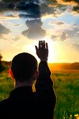 image of rapture  - young man silhouette on sun set background - JPG