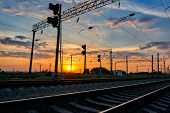 railroad infrastructure during beautiful sunset and colorful sky, railcar and traffic lights, transp poster