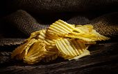 Potato Chips On Rustic Wooden Table poster