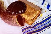 Top View Of Shofar Horn On White Prayer Talit. Prayer Shawl - Shofar Torah And A Kippah A Yamolka Ho poster