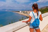 Young Tourist Woman On The Beach And Sea Landscape With Sperlonga, Lazio, Italy. Scenic Resort Town  poster