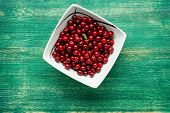 Fresh Cherry On Plate On Green Wooden Background. Fresh Ripe Cherries. Sweet Cherries. Sweet Cherry  poster