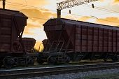 railcar for dry cargo during beautiful sunset and colorful sky, railroad infrastructure, transportat poster