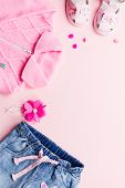 Little Girl Clothes Collection Flat Lay With Pink Cardigan, Jeans, Sandals On Pink Background. Top V poster