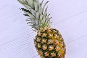 Ananas On Wooden Background, Top View. Delicious Tropical Fruit On Light Textured Wood. Healthy And  poster