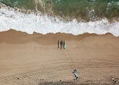 Seascape With Waves And Shadows Of Walking People. Top View Aerial Photo From Flying Drone Of Nature poster