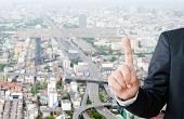 Businessman Hand Touching Blank Search Bar Over Blur City Background, Business And Technology Concep poster