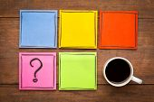 question mark and blank reminder notes - handwriting on colorful sticky notes with a cup of coffee poster