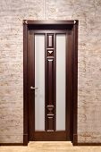 Brown Metal With Wooden Overlays Entrance Door With Brass Handle And Frosted Matte Glass With Floor  poster