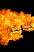picture of truncheon  - Burning flame or fire isolated on black background - JPG
