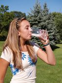 picture of drinking water  - teenage girl drinking water in a glass - JPG