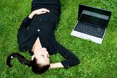 Businesswoman Sleeping Beside A Laptop