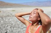 foto of fatigue  - Desert woman thirsty dehydrated in Death Valley - JPG