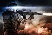 image of gunshot  - assault soldier with rifle on apocalyptic clouds - JPG