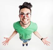 Funny Handsome Man With Hipster Glasses Showing His Palms And Smiling Large  - Wide Angle Shot