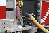stock photo of hookup  - detail of hose hookups on a fire truck - JPG