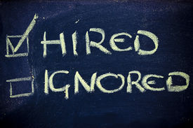 picture of ignore  - chalk writings on blackboard hired vs - JPG