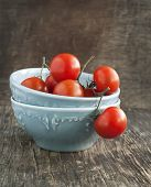 Fresh Tomatoes In Bowl On Woden Table