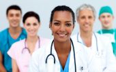 picture of medical staff  - Attractive female Doctor standing before her team - JPG
